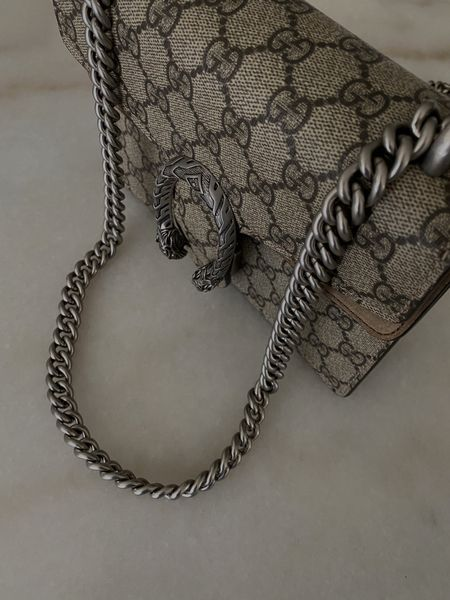 Marble table  Gucci bag