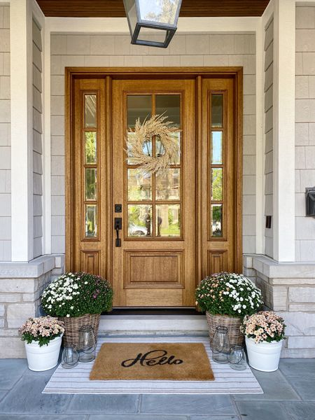 Fall front porch decor!! I used the small size of these rattan planters! Also tried to find some more white planter options for you guys! Don't miss this wreath, love it!! Also 3x5 outdoor rug to create this layered look!   #falldecor #frontporch #fallplanters  #LTKSeasonal #LTKunder100 #LTKhome
