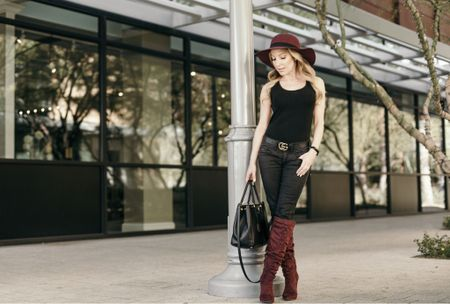 Black jeans & a black bodysuit are perfect layering pieces for Fall outfits to go with your Fall boots to create so many different looks. Add berry colors like red knee high boots & red felt hats for a festive Fall/Winter vibe. A black leather logo belt like a Gucci belt & black tote bag are classic accessories.  #LTKshoecrush #LTKSeasonal #LTKstyletip