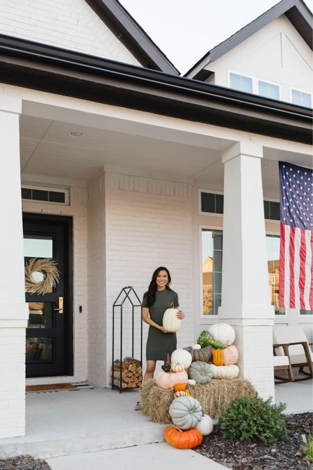 Fall front porch decor with faux pumpkins and real pumpkins, fall wreath for our door, log holder, birch firewood, outdoor furniture with rocking chairs and more. Also linking my outfit, which is 25% off. Wearing  size xs.   #LTKunder100 #LTKhome #LTKSale
