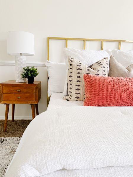 Brass bed headboard and a mid century modern wood nightstand.  Metal headboard, gold headboard, bedroom furniture, nightstands, bedroom decor, lumbar pillow  #LTKhome