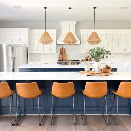 Simply in love with all of the details from our Boho Farmhouse Kitchen Reveal! My favorite find are these three rattan light pendants and they are on sale now!   #bohofarmhouse #modernfarmhouse #rattan   #LTKsalealert #LTKhome