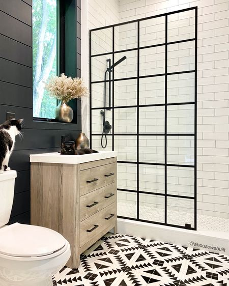 Our powder bathroom sink most often has a napping kitty in it and right now, Matcha's trying to convince Nyx to give her a turn… This vanity is one of our only non-custom cabinetry pieces. I picked it because the countertop was already a great match for our home and I loved the gray-toned wood look it came with so an easy way that we customized it to fit our style was to swap out the hardware for my favorite matte black drawer pulls and it fit right in! — Shop your screenshot of this pic with the Shop.LTK app
