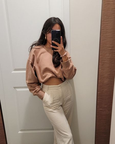 AE came out with their new sweatshirts for fall and they're so good! They're very thick and soft with a worn in vintage feel. I'm wearing the brown 🤎 in size medium.   I wore it with wide leg pants for a cute neutral outfit. My pants are Zara but found these super similar trousers from Abercrombie  http://liketk.it/3lBQT @liketoknow.it #liketkit #LTKunder50 #ltkfall