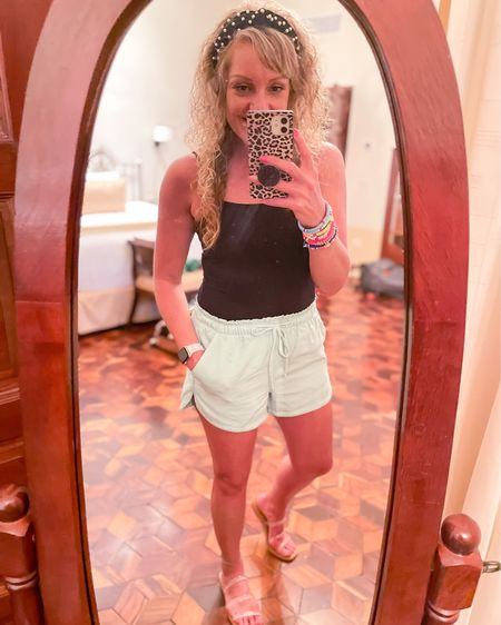 Vacay shorts Aerie TTS wearing size small / black bodysuit size medium / beach vacation / clear strappy sandals TTS / resort outfit / high waisted tie front http://liketk.it/3jiz8 #liketkit @liketoknow.it #LTKtravel #LTKstyletip #LTKunder50