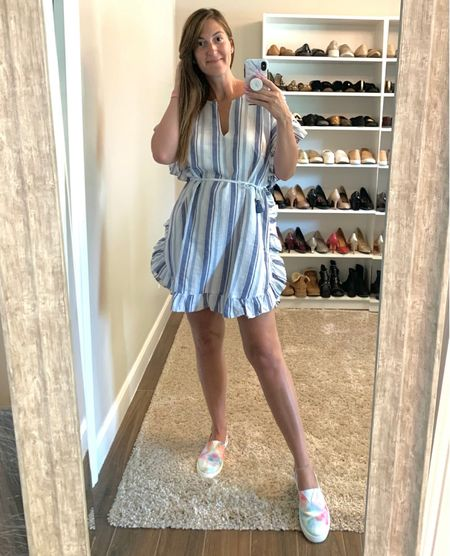 This tunic makes for the perfect coverup so I had to get it in two colors! STYLE TIP: wearing vertical stripes is an easy way to make yourself look taller! 😉   This little number is currently on sale + an extra 60% off! Runs TTS. I'm wearing a medium.  Oh, and these slip on's are so comfy + under $40! Linked other tie dye variations too!  #LTKsalealert #LTKunder50 #LTKstyletip
