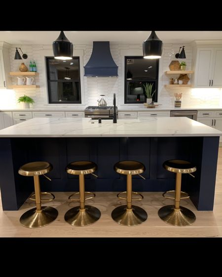 A fun Bar Stool can make a kitchen. We get asked about these golf swivel bar stools all of the time. http://liketk.it/2Rc7W #liketkit @liketoknow.it @liketoknow.it.home    Follow me on the LIKEtoKNOW.it shopping app to get the product details for this look and others