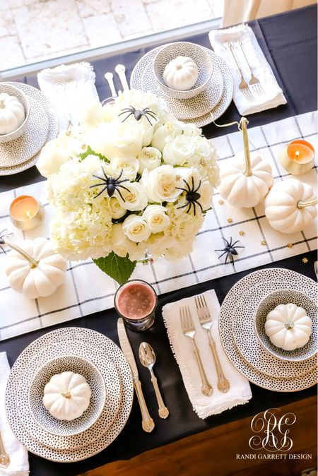 Fun black and white table that can be used year round minus the spiders using some of my favorite dishes and bee flatware from Wal Mart     #LTKhome #LTKSeasonal #LTKHoliday