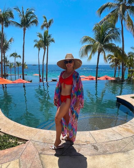 What kind of tree fits in your hand?    ----  A palm tree! 🌴   😂😂😂 Ok the joke was bad but this place is absolutely amazing! I Highly recommend Hacienda Beach Club and Residences in Cabo!! Everything has been absolutely amazing! This Kimono and two piece suit is one of my favorite combos. I love the vibrant colors! Link to this is in my bio under my LIKEtoKNOW.it ~   http://liketk.it/3hjkC #liketkit @liketoknow.it