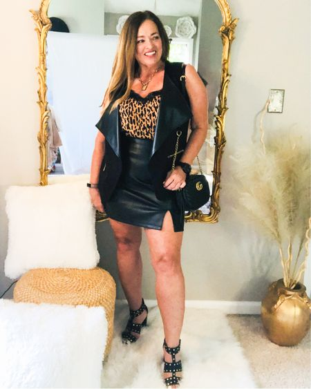 The faux leather trend for Hot girl Summer continues, wearing a sleeveless faux leather collar vest with my skirt. Add leopard camisole and studded heels and D inspired purse and you have a great date night look... Have you tried faux leather items/accessories for the Summer? . . . . . . http://liketk.it/3gUga #LTKstyletip #LTKcurves #LTKitbag #liketkit @liketoknow.it.family @liketoknow.it You can instantly shop my looks by following me on the LIKEtoKNOW.it shopping app
