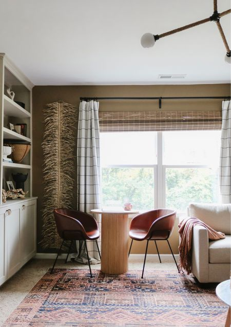 Reading nook, windowpane curtains, windowpane drapes, leather chair, leather dining chair, vintage rug, tribal rug   #LTKhome #LTKunder100
