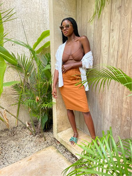 Summer vacation outfit from J. Crew. Rust orange skirt, 90s swim top bikini, striped button shirt and green strappy sandals for the beach.   #LTKtravel #LTKunder100 #LTKswim