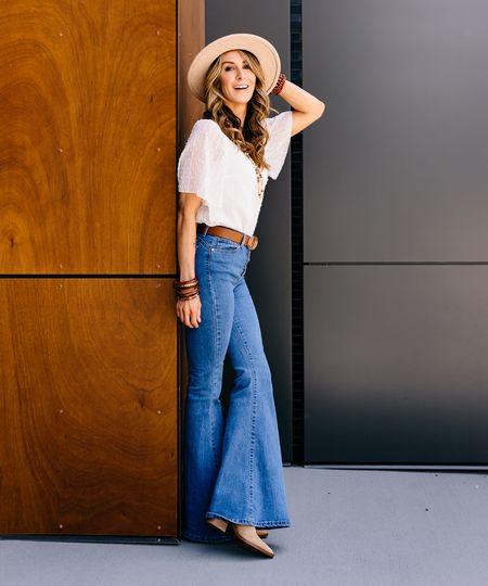 Boho Vibes! Gah, I love a good pair of flared jeans.  Top: $13 Jeans: $27 Hat: $22 Belt: $10 Booties: $99   #LTKsalealert #LTKstyletip #LTKunder50