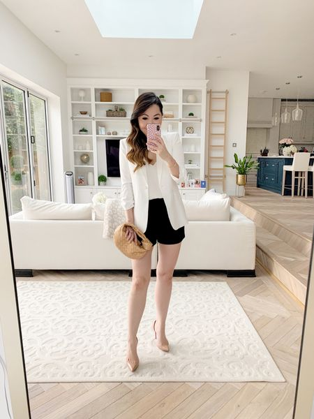 Tailored summer look with tailored black shorts, a fitted white blazer, white silk cami, Bottega Veneta Mini Jodie and Christian Louboutin Iriza pumps ✨  I sized down in the blazer, taking a size 00. I took a size 2 in the Vince shorts and a size US 6/ UK 10 in the more affordable ASOS shorts. I took an XS in the cami 😊