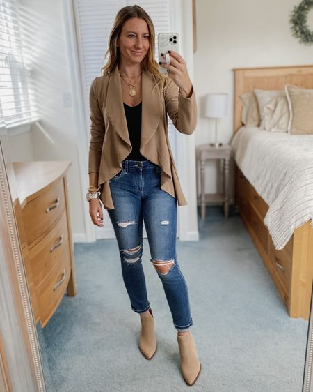 Lightweight cardigan, black bodysuit, ripped jeans, brown boots  http://liketk.it/324X7 #liketkit @liketoknow.it #LTKunder50 #LTKstyletip