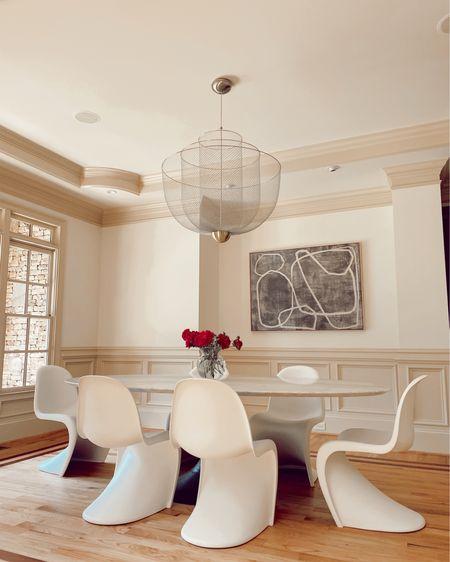Chandelier oval table and killer Pantone chairs @liketoknow.it http://liketk.it/3hT9h #liketkit dining room #LTKhome #LTKsalealert #LTKstyletip
