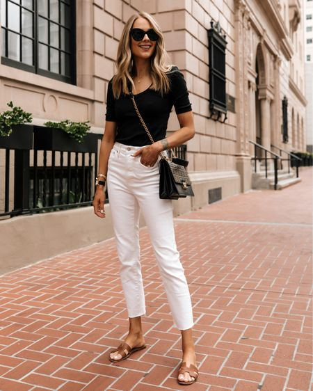 An effortless minimal look that can be worn almost all year! Paired with some of my favorite designer accessories. My go-to pair of white jeans with raw hem. They aren't see-through and they have stretch. Def size down (maybe 2 sizes) they run big! This little black ribbed top is super flattering! Linked Hermès sandals and similar styles http://liketk.it/3izgs #liketkit @liketoknow.it #LTKstyletip #LTKunder100 #LTKshoecrush #whitejeans #hermessandals #fendi #summeroutfit