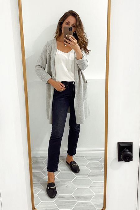 Jeans tts for me.  Cardigan in xs (you can size down depending how you like it to fit).