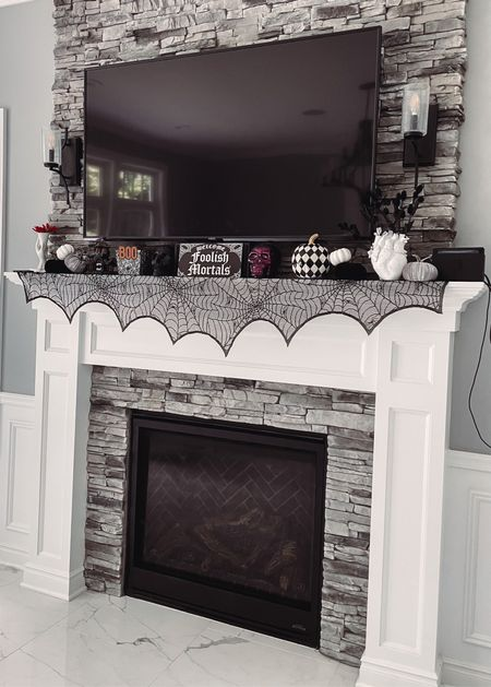 I'm loving this year's mantle decor! I found lots of good Halloween decor on sale this weekend and the rest of the fall decor I already had. Most under $20!   #LTKSeasonal #LTKunder50 #LTKhome