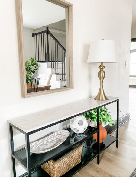 Love how this modern console is styled with a simple rectangular mirror and gold lamp.  Console style, living room decor, dining room decor, gold Lamp, mirror, shelf accessories  #LTKhome
