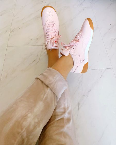 Loving these blush pink Reebok classics 💖 👟 My Mother's Day gift to myself! So comfy and cute for Spring. Pair with tie dye joggers and tank - Perfect casual airport travel outfit airplane ✈️  . .  http://liketk.it/3eFYm #liketkit @liketoknow.it #LTKshoecrush  #LTKunder100 #LTKsalealert Nashville outfits, vacation outfits, maternity style, summer fashion, Mother's Day gift guide, travel outfit, casual style, athleisure, tennis shoes, airport outfit, plane attire, pink tennis shoes