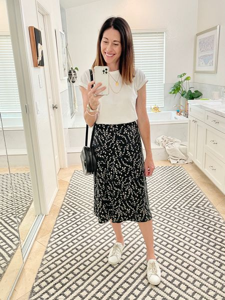 Wearing an old favorite slip skirt from Baukjen but linked a similar style from @madewell fits true to size Shoes are the Eda Leather tennis shoe from @fredasalvador and I sized down 1/2. They are ON SALE this weekend for 20% off with code SUMMERLOVE  Bag is vintage and shirt is Advocate the Label   #LTKstyletip #LTKsalealert #LTKSeasonal
