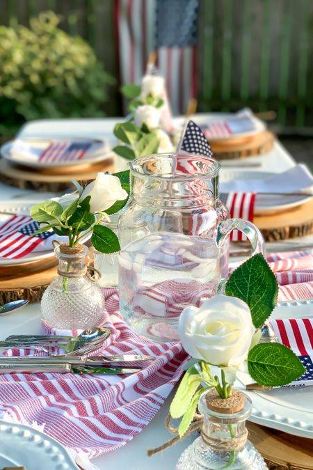 Target 🎯 Finds for the perfect Independence Day Party!!❤️🤍💙   With these entertaining essentials and American Flags❤️🤍💙 you'll be ready for July 4th & your summer barbecues in no time! 🙌  Wood Slice Charger paired with the white florals, Glass Pitcher and glass mason jars  create a beautiful tablescape that's sure to impress!❤️🥰   Follow me on the LIKEtoKNOW.it shopping app to get the details for these items and other great finds!    http://liketk.it/3i1q3    #liketkit   @liketoknow.it.home @liketoknow.it.family @liketoknow.it  #LTKunder50 #LTKhome #LTKfamily   #July4th #summerbbq #summerpicnic #outdoorparty #summerparty #PatrioticDecor #Redwhiteandblue