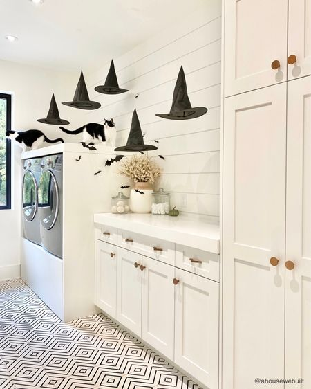 Our laundry room got some fun Halloween decor! I hung these witch hats from our ceiling with fishing line and scotch tape. I actually originally thought I'd need to use command hooks but they're so lightweight that a couple pieces of tape does the trick… and they're so fun!! (Cat cameos by Chai & Mocha) — Shop your screenshot of this pic with theShop.LTKapp