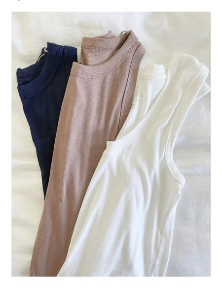 Two styles of my favorite tanks for under $10! I wear size small. Great for with midi skirts, under cardigan sweaters or with high waisted denim! Target find   #LTKunder50