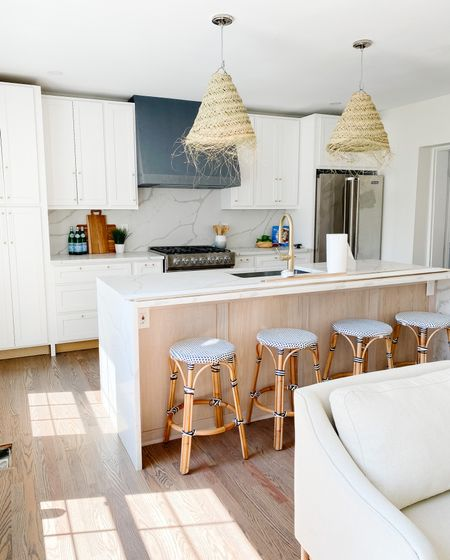 Sweet French bistro stools in tangos modern kitchen with straw island pendants.  Kitchen decor, kitchen stools, natural pendants, counter stools, kitchen island    #LTKhome
