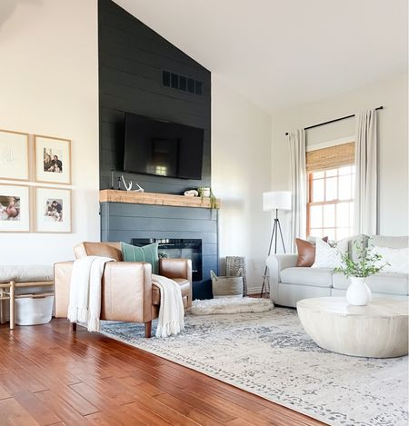 Neutral living room with pops of color. DIY shiplap fireplace.       #LTKhome