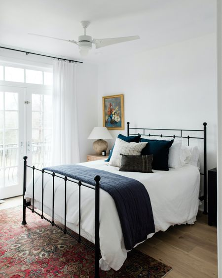 I was gonna do a whole blog post on this room tonight, but decided this may be easier for you guys to digest!  Meet the guest bedroom at my parents house with deep Texas roots. Unlike their Northern California coastal inspired master bedroom, this one is about Austin. We sourced a vintage inspired iron bed, paired it with a vintage rug, added in some linen layers and made it feel modern with a gorgeous @mcgeeandco nightstand and substantial lamp. To top it all off, we featured (surprise surprise) more of my grandmas vintage artwork - Texas wildflowers!  Big thank you to @lindseybrookedesign for sweetly styling this space for us at Design Camp!   Screenshot this pic to get shoppable product details with the LIKEtoKNOW.it shopping app or follow me on @liketoknow.it #liketkit http://liketk.it/2LoA6