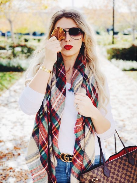 If this scarf isn't a statement piece for fall! The nude tunes with red and blue! I linked my go to aviator sunnies and preloved options for my Louis Vuitton neverfull. #competition   #LTKSeasonal #LTKsalealert #LTKstyletip
