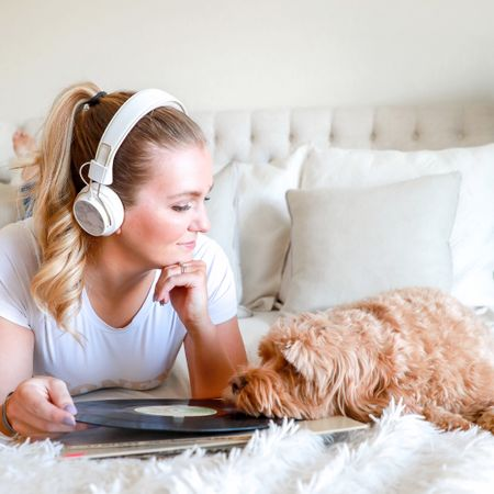 """Feelin' ready to rock out this week 🤘🏽 but Lucy is clearly feelin' a slow jam  🐾 ⠀ I've consistently used my @sudio headphones for over a month now, and wanted to update: I'm in love! 🎧 Amazing sound quality + gorgeous, comfy design- does not disappoint! // Use my code, """"ANNALAURASOMMER"""" for 15% off a pair of any #sudio wireless headphones!⠀ ⠀⠀ 📸 @theshinestudioco ⠀ #sudiomoments⠀ ⠀ P.S. Mixed it up and linked some home decor from this photo over on @liketoknow.it // #liketkit  ⠀ ⠀ ——— #phillyinfuencer #phillyblogger #ltkunder50 #ltkunder100 #phillystyle #collaborations #phillylooks #homedecor #ltkhome #ltkstyletip #bedroomstyle #cozybedroom #bedroomideas #rewardstylebloggers #decorcrushing #mycreativeinterior #mywhiteweekend #howphillyseesphilly #influencerstyle #influencermarketing  http://liketk.it/2AHfd"""