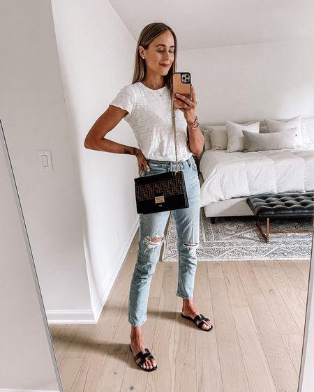 Casual summer style #fendihandbag #whitetshirt #rippedjeans #sandals #sunmerfashion http://liketk.it/3fRLh #liketkit @liketoknow.it #LTKshoecrush #LTKitbag #LTKstyletip
