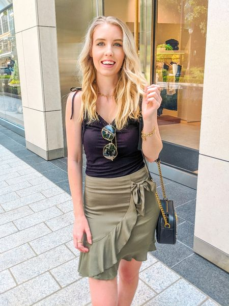 An outfit for the hot weather but still fall colors. Pair a black tank top with a green wrap skirt.   #LTKSeasonal #LTKstyletip #LTKunder50