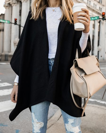 Love this black poncho for fall! So easy to layer over a causal outfit and great for travel outfits too! #poncho #falloutfit   #LTKunder50 #LTKunder100 #LTKstyletip