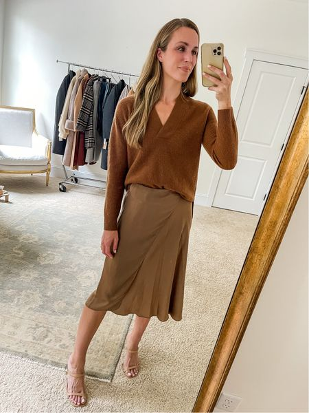 One of my favorite sweaters from the Nordstrom Anniversary Sale is restocked! I'm wearing an XS. It's soft, can be dressed up or down, and is the prettiest rust color. I linked 3 similar brown sweaters I love, too, in case it sells out. Wearing size 2 in the skirt. #nsale #fallsweaters #vnecksweater #burntorangesweater #fallskirts #brownsweater #falloutfitswomens