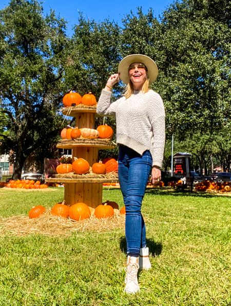 Pumpkin patches abound this time of year and I love them! Let's get cozy in a chic fall hat (also available in brown), soft sweater and the best fall boots around! #fallboots #rainboots #rainshoes #teddybearsweater #spanxdenim #fallstyle2021 #fallstyle #plussizefashion   #LTKcurves #LTKSeasonal #LTKshoecrush