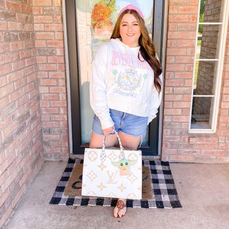Spring everyday outfit running errands revolve graphic sweatshirt Beverly Hills Louis Vuitton purse shop Disney baby yoda bag charm Tory burch sandals lele Sadoughi headband  #LTKitbag #LTKSeasonal #LTKunder100