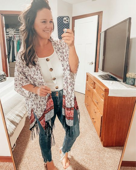 Mamas out there seeing this... you NEED these jeans. I can't even begin to tell you how many compliments I get. They are perfectly high waisted & the perfect stretch! I got this cute kimono from the Bunkhouse Boutique but linked a bunch of cute ones! The tank is just the right amount of crop and tucks in perfectly! http://liketk.it/3f7QZ #liketkit #LTKunder50 #LTKstyletip #LTKworkwear @liketoknow.it