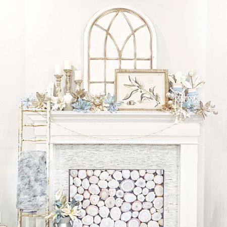 """Ahhhh the transition from holiday decor, to winter decor! I took the floral stems off my tree, and placed them on the mantel to have that """"garland"""" look, and took the bead garland off the tree as well and put it up! It's the little things people!  • •  http://liketk.it/2z7kQ  •  You can instantly shop all of my looks by following me on the LIKEtoKNOW.it app @liketoknow.it #liketkit @liketoknow.it.home #LTKholidaystyle #LTKholidayathome #LTKhome"""
