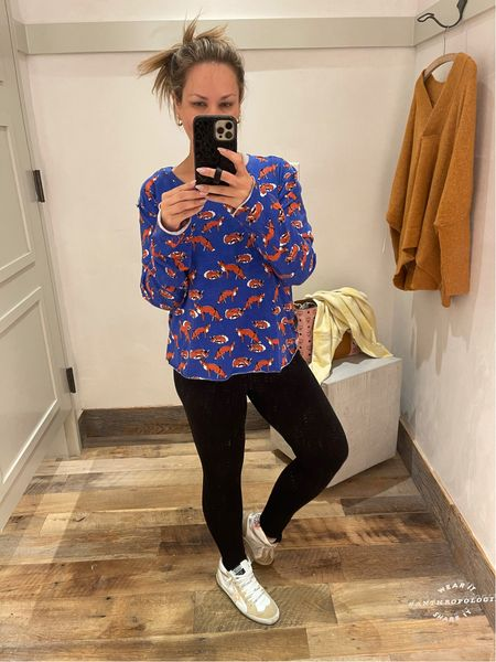 I love this shirt from Anthropologie!! Size up, it's cropped. Wearing large. Golden goose tts   #LTKSeasonal #LTKshoecrush #LTKunder50