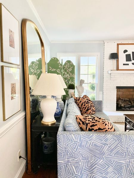 Living room decor, blue sofa, leaning mirror, tiger pillows. chinoiserie screen    #LTKhome