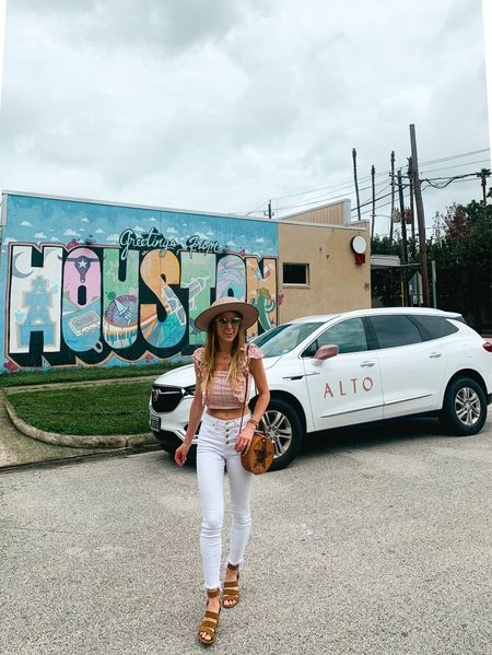 Exploring Houston with Alto in my high waisted white jeans, pink smock crop top, tan fedora hat, round rattan bag and pink sun glasses, and signature bracelet stack that I wear EVERYWHERE. Tagging a few similar Jean styles bc my front button Madewells don't have all sizes in stock.   #LTKunder50 #LTKtravel #LTKitbag