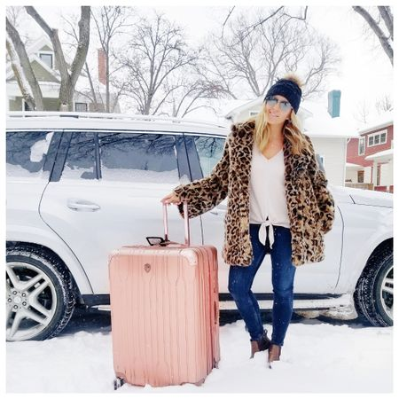 My coat and suitcase took up the whole vehicle so the boys couldn't come. JK they're in there. 💗   My coat is brand new under $110 and my luggage is on mega sale. My knotted shirt is super soft (almost like pjs). I've linked a ton of other leopard coats and rose gold luggage.  Find the links to shop on my website (link in my bio), or follow #LTKstyletip me in the @liketoknowit app, OR copy and paste this link in your browser. http://liketk.it/2zGnN   @liketoknow.it #liketkit