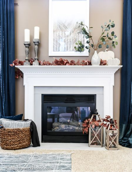 Fall inspired mantel decor for your fireplace. Tip: Balance colors in a visual triangle to create a flow!  #LTKhome #LTKSeasonal #LTKstyletip