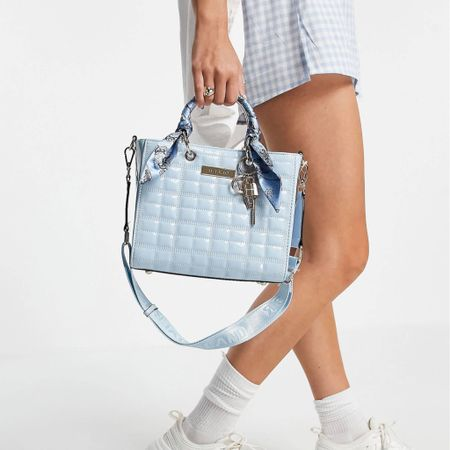 Designer dupe alert! This ASOS bag reminds me of the iconic Dior lady bag but a hell of a lot cheaper!!! So cute and so affordable http://liketk.it/3jybH @liketoknow.it #liketkit #LTKunder50 #LTKitbag #LTKwedding @liketoknow.it.europe @liketoknow.it.family Shop your screenshot of this pic with the LIKEtoKNOW.it shopping app