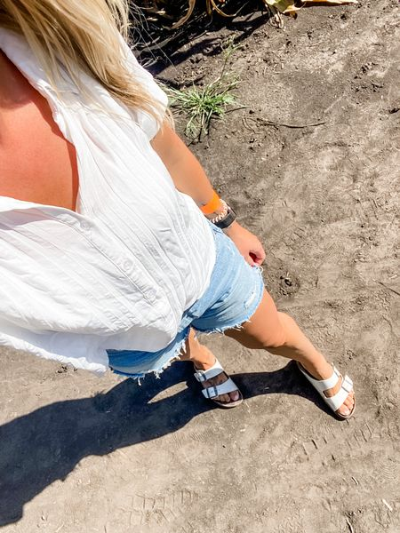 Family date to the corn maze! I've had this top for years and it's a good one. It's easy to dress up or down 🙌🏼 Pro tip: don't wear white sandals to the corn maze. 😆  #ootd #whitetop #buttonup #sandals #birkenstocks #indiansummer #outfit #shorts #denim #agolde   #LTKstyletip #LTKunder50 #LTKSeasonal