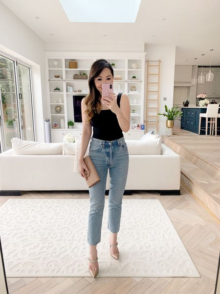 Straight leg jeans which are *actually* flattering on ladies with hips! I took a size 27 (TTS for me but I have wide hips. Otherwise I would say to size down 😊)  Teamed with my Jimmy Choo bing heels, Valentino clutch and a simple, affordable square neck black tank top ✨